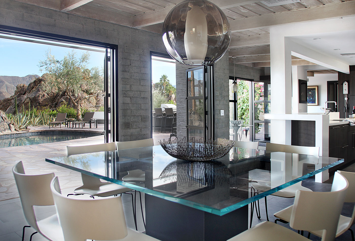 05 Dining+room+with+french+doors+opening+to+oasis+pool+and+unobstructed+views+of+mountains